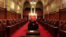 A Senate pages prepare the Senate Chamber before the start of Question Period. (DAVE CHAN FOR THE GLOBE AND MAIL)