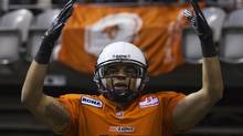 BC Lions wide receiver Nick Moore reacts to the crowd as he celebrates his touchdown against the Saskatchewan Roughriders during the second half of their CFL football game in Vancouver, British Columbia June 13, 2012. ) (ANDY CLARK/REUTERS)