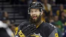 When Brent Burns packs his bags for road trips, the Sharks defenseman usually leaves some cosmetic teeth behind. (Mark Humphrey/AP)
