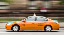 Acabdrives before a protest held by Taxi drivers against Uber inToronto, Monday June 1, 2015 (Mark Blinch/The Globe and Mail)