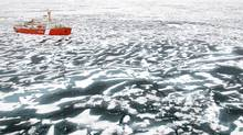 The Canadian Coast Guard ship Louis S. St. Laurent breaks ice near the mouth of Bellot Strait in the Northwest Passage, July 21, 2007. (JONATHAN HAYWARD/CP)