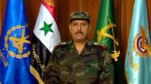 General Fahd Jassem al-Freij, Syria's new Defense Minister, reads a statement after he was appointed by President Bashar al-Assad. The former defense minister, Dawoud Rajha, was killed by a bomb in Damascus on Tuesday. (SANA/Associated Press)