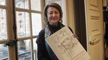 Art historian and Van Gogh specialist Bogomila Welsh-Ovcharov poses with the book Vincent Van Gogh The lost Arles Sketchbook. Some art experts dispute that a book of previously unpublished drawings are authentic. (Christophe Ena/AP)