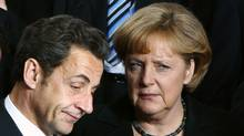 France's President Nicolas Sarkozy and Germany's Chancellor Angela Merkel. (Francois Lenoir/REUTERS)