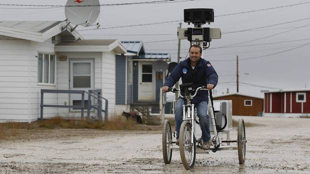 <p>A man rides a Google Street View bicycle that is mapping the area in Cambridge Bay, Nunavut on Aug. 23, 2012.</p>
