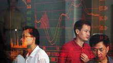 Investors view stock index at a securities company on August 23, 2007 in Wuhan of Hubei Province, China (China Photos/2007 China Photos)