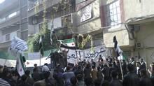 Demonstrators protest against Syria's President Bashar al-Assad in Erbeen near Damascus December 14, 2012. (Bassam Al-Erbeeni/Shaam News Network/Handout/REUTERS)