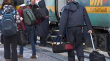 Passengers board a Via train in Truro, N.S. in this file photo from January, 2013. (Andrew Vaughan/THE CANADIAN PRESS)