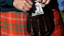 Scots go to the polls on Sept. 18 to vote on whether or not they wish to remain part of the United Kingdom. The issue of currency and a backstop by the Bank of England in the event Scotland became independent is high on the list of issues being debated. (RUSSELL CHEYNE/REUTERS)