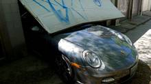 This Porsche Turbo boasts 500 horsepower, a leather-lined cockpit and a 330 km/h top end* (*Unless jammed under a garage door). (Peter Cheney/The Globe and Mail)