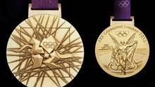 In this image made available by the London Organising Committee of the Olympic Games on Wednesday July 27, 2011 shows London 2012 Olympic gold medal designed by British artist David Watkins. The front of the medal is on the right, all medals are 85mm in diameter. With one year to go until the opening ceremony of the 2012 Olympic Games, London organizers completed the last of the Olympic Park's permanent venues Wednesday July 27, 2011 and promised to put on a safe and spectacular event that will captivate the world. (AP Photo/LOCOG, HO) (LOCOG/AP)