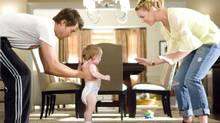 Josh Duhamel as Eric Messer and Katherine Heigl as Holly Berenson, plus a baby, in a scene from Life as We Know It. (Peter Iovino/Warner Bros.)