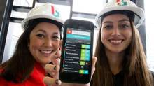 Lauren Hasegawa, left and Mallorie Brodie are the co-founders of Bridgit, a company that makes software that tracks construction deficiencies. (Glenn Lowson For The Globe and Mail)