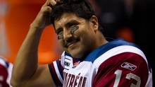 Montreal Alouettes quarterback Anthony Calvillo scratches his head as he sits on the bench while playing the B.C. Lions during the second half of a CFL game in Vancouver, B.C., on Saturday November 5, 2011. (DARRYL DYCK/THE CANADIAN PRESS)