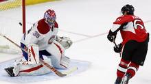 Ottawa Senators' Erik Karlsson (65) shoots the puck past Montreal Canadiens goalie Al Montoya (35) to beat the Canadiens 4-3 in shootout NHL action, in Ottawa on Saturday, October 15, 2016. (FRED CHARTRAND/THE CANADIAN PRESS)