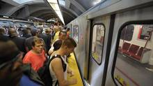 Passengers board a subway car in Toronto made by Bombardier Transportation on July 21, 2011. Bombardier announced a deal to manufacture rail cars for San Francisco's transit authority on June 14, 2012. (Fred Lum/The Globe and Mail)