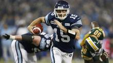 Toronto Argonauts quarterback Ricky Ray runs the football against the Edmonton Eskimos during the first half of the East Division semi-final CFL game in Toronto, November 11, 2012. (MARK BLINCH/REUTERS)