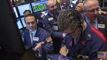 Traders work on the floor of the New York Stock Exchange, October 25, 2013. (BRENDAN MCDERMID/REUTERS)