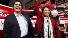 Federal Liberal Leader Justin Trudeau raises provincial Liberal by-election candidate Sandra Yeung Racco's arm at her campaign office after speaking to supporters in Thornhill, Ont., on Jan. 16, 2014. (NATHAN DENETTE/THE CANADIAN PRESS)