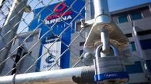 A padlock is seen on a parking lot gate outside Rogers Arena, the home of the Vancouver Canucks NHL hockey team, in Vancouver, B.C. (DARRYL DYCK/THE CANADIAN PRESS)