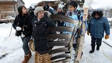 Attawapiskat Chief Theresa Spence is helped back to her teepee after greeting and welcoming supporters as they visit her on Victoria Island in Ottawa on Thursday, January 3, 2013. Spence is in her fourth week of a hunger strike calling on Harper to meet and discuss First Nations issues. (Sean Kilpatrick/THE CANADIAN PRESS)