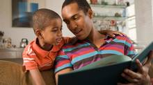 Father and son reading book (Jupiterimages/Getty Images/Polka Dot RF)