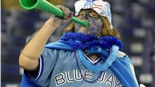 A Blue Jays fan cheers on the team during Opening Day at the Rogers Centre this season. (Dave Sandford/2009 Getty Images)