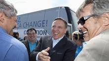 Coalition Avenir Quebec leader Francois Legault, centre, is greeted by local candidates as he arrives at a sports bar in Quebec City on Tuesday. (Jacques Boissinot/The Canadian Press)