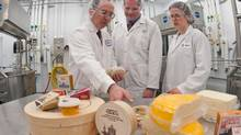 Agropur's Michel Pouliot, left, and Manon Duquenne, right, work at their R&D centre in St-Hubert, Que., with Laval University's Steve Labrie. (Benoit Desjardin/Genome)