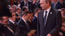 "Russia's President Vladimir Putin arrives as Canada's Prime Minister Stephen Harper and US President Barack Obama look on during the G20 Summit ""welcome country"" ceremony at the Brisbane Convention and Exhibition Center on November 15, 2014 in Brisbane, Australia. (Mandel Ngan/AFP/Getty Images)"