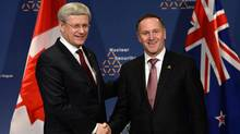 Prime Minister Stephen Harper meets with New Zealand Prime Minister John Key at the Nuclear Security Summit in The Hague, Netherlands, earlier this year. (Sean Kilpatrick/THE CANADIAN PRESS)
