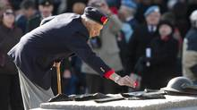 A veteran places his poppy on the Tomb of the Unknown Soldier during Remembrance Day ceremonies in Ottawa on Nov. 11, 2009. (Adrian Wyld/Adrian Wyld/The Canadian Press)