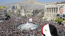 Tens of thousands of Syrians gather for a pro-government rally at the central bank square in Damascus March 29, 2011. Syrian President Bashar al-Assad accepted his government's resignation on Tuesday after nearly two weeks of pro-democracy unrest that has posed the gravest challenge to his 11-year rule. (Wael Hmedan/Reuters)