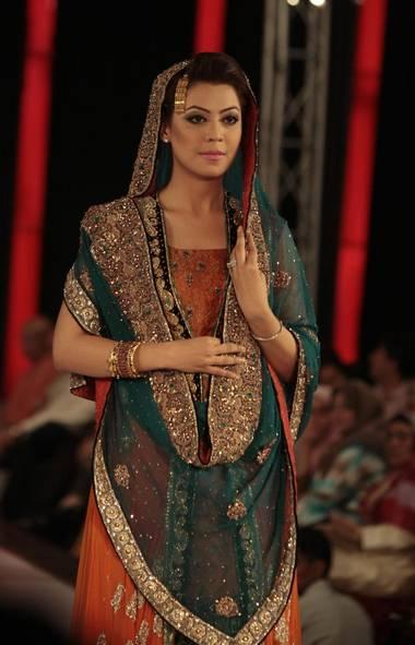 A model wears a creation by designer Erum Khan at Islamabad Fashion Week (FAISAL MAHMOOD/REUTERS)