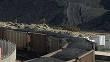 According to lawsuit, open-top coal cars spill toxic dust and water, especially on rough track and steep grades. (Jeff Vinnick/The Globe and Mail)