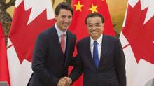 Chinese Premier Li Keqiang, right, shakes hands with Canadian Prime Minister Justin Trudeau following a joint news conference at the Great Hall of the People in Beijing, China, Wednesday, Aug. 31, 2016. (Adrian Wyld/THE ASSOCIATED PRESS)