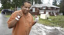 Maninder Gill walks outside of his home in Surrey, B.C. Mr. Gill's home was shot at in a hail of gunfire on Sept. 20, 2010. (Jeff Vinnick for The Globe and Mail)