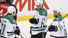 Dallas Stars' Tyler Seguin (91) celebrates his goal with teammates Jamie Benn (14) and Trevor Daley (6) during the second period of an NHL hockey game against the Florida Panthers in Sunrise, Fla., Sunday, April 6, 2014. (Terry Renna/AP)