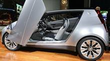 The Cadillac Urban Luxury Concept (ULC) at the L.A. Auto Show in Los Angeles on November 17, 2010. The ULC has gull wing doors, a footprint of only 151 inches long and 68.1 inches wide and seats four. (ROBYN BECK/AFP/Getty Images)
