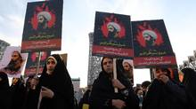 Iranian women gather during a demonstration against the execution of prominent Shiite Muslim cleric Nimr al-Nimr by Saudi authorities, at Imam Hossein Square in the capital Tehran on January 4, 2016. (ATTA KENARE/AFP/Getty Images)