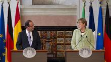 French President Francois Hollande, left, and German Chancellor Angela Merkel attend a joint press conference with Italian Premier Mario Monti and Spanish Premier Mariano Rajoy at the end of a meeting in Rome, Friday, June 22, 2012. (Andrew Medichini/AP)