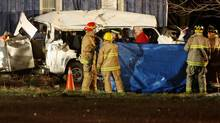 Ontario Provincial Police and emergency crews investigate a motor vehicle accident that killed 11 people near Hampstead, Ont., on Feb. 6, 2012. (DAVE CHIDLEY/Dave Chidley/The Canadian Press)