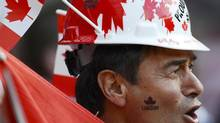 A Canada fan waits before the women's semi final soccer match against the USA at the London 2012 Olympic Games at Old Trafford in Manchester, August 6, 2012. REUTERS/Nigel Roddis (BRITAIN - Tags: SPORT OLYMPICS SPORT SOCCER) (NIGEL RODDIS/REUTERS)