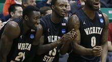 Nick Wiggins, centre, seen with Wichita State players Ron Baker, left, and Chadrack Lufile, is the older – and slower – brother of the much-ballyhooed No. 1 draft pick Andrew Wiggins. (GEORGE FREY/AP)