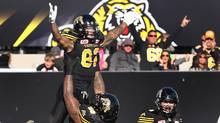 Tiger-Cats Brian Tyms and Terrence Campbell celebrate a touchdown last week. Hamilton plays host to Edmonton on Sunday. (Peter Power/THE CANADIAN PRESS)