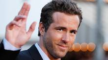 Cast member Ryan Reynolds waves at the world premiere of the film The Change-Up in Los Angeles August 1, 2011. (Danny Moloshok/Reuters)