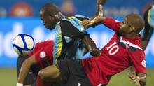 Canada's Simeon Jackson (R) and St. Lucia's Bernard Edward fight for the ball during their 2014 World Cup Qualifying soccer game in Toronto September 2, 2011. REUTERS/Fred Thornhill (Fred Thornhill/Reuters)