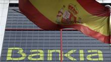 A Spanish flag flutters beside Bankia's headquarters in Madrid on May 30, 2012. (Sergio Perez/REUTERS)