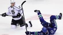 Vancouver Canucks center Ryan Kesler (17) and Los Angeles Kings right wing Dustin Brown (23) collide during first period NHL Stanley Cup playoff hockey action at Rogers Arena in Vancouver, B.C. Wednesday. (JONATHAN HAYWARD/The Canadian Press)