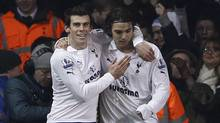 Tottenham Hotspur's Gareth Bale (L) congratulates team mate Niko Kranjcar after he scored against Newcastle United during their English Premier League soccer match at White Hart Lane in London February 11, 2012. (STEFAN WERMUTH/Reuters)